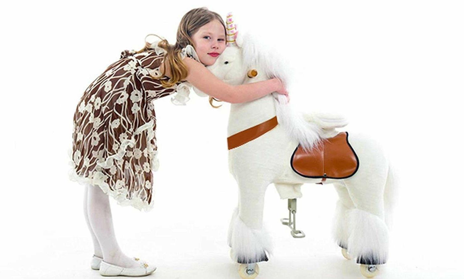 kids riding toy unicorn horse cycle indoor