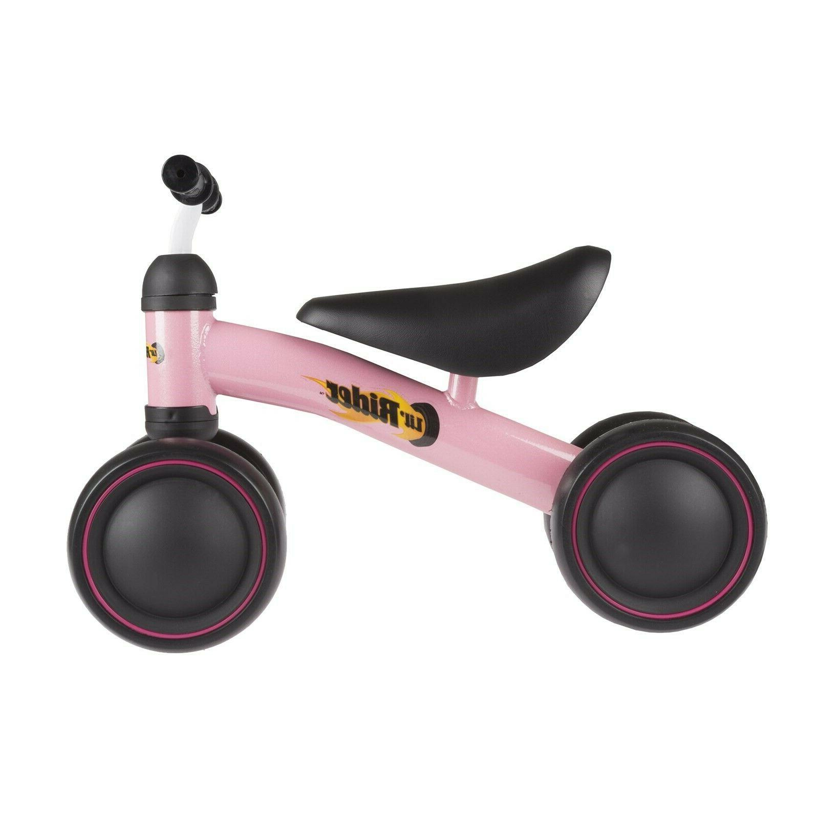 Pink Baby on Toy Bike No